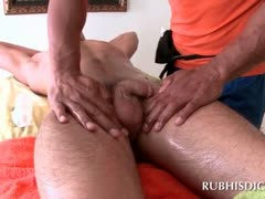 Gay black masseur rubbing his clients cock with oil