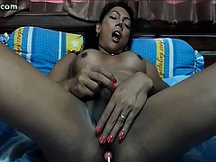 Shemale masturbating with a candy