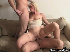 lonely-granny-swallows-two-cocks