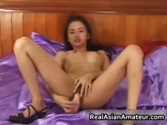 petite-asian-babe-strips-and-dildo-part3