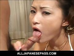 Japanese Goddess In White upon Her Knees Sucking Dick