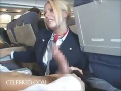 Sexy stew sucking and stroking dick on plane uniform blowjob big tits big cock handjob blonde funny