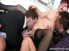 mature-office-bitch-enjoys-two-cocks